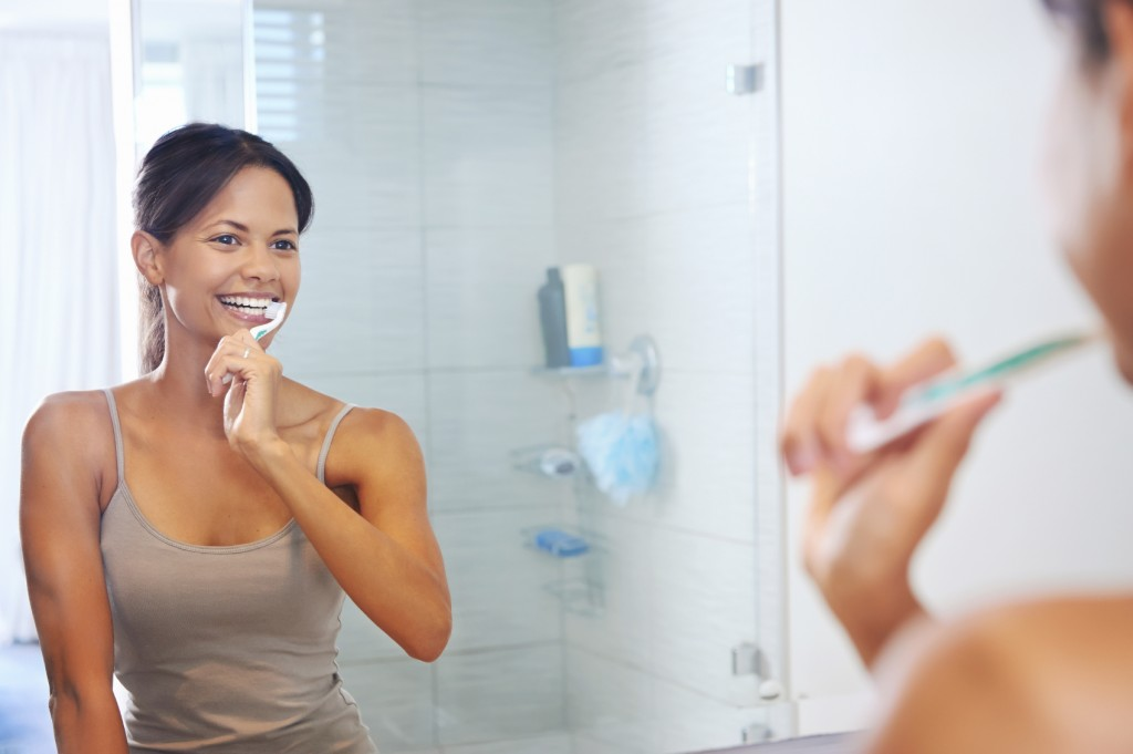 Woman Brushing Teeth - iStock_000023613565_Medium